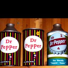 Wouldn't you like to be a pepper too? Mint cone-top and flat-top soda cans.