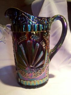 Westmoreland Carnival Glass God and Home Pitcher in Amethyst.
