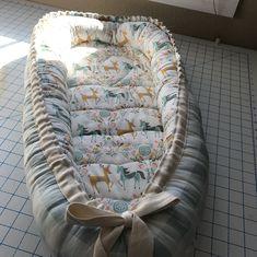 Handmade baby nest by @suzan_cunningham featuring Kingdom fabric by Hawthorne Threads