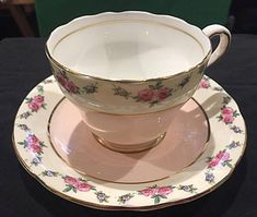 Aynsley English Bone Tea cup and saucer. Rose Design, gold rim , dusty pink color background . 1930's -1940's.