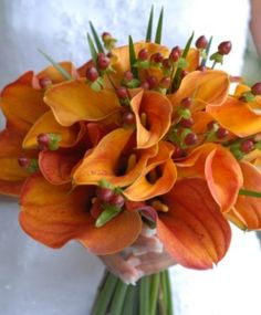 Autumn wedding bouquet using lilies. Visit prettyasapicture.ie, an award winning wedding invitation and gift boutique based in Ireland.
