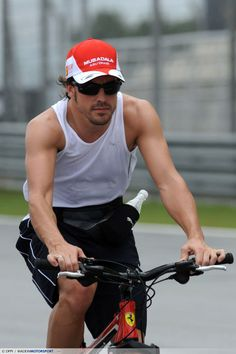 Breathtaking Fernando Alonso in two wheels... *_* You will never see him in this shirt in F1... only on Pinterest :-D