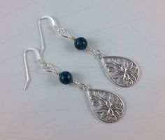 A personal favorite from my Etsy shop https://www.etsy.com/listing/222910174/lotus-flower-and-blue-apatite-earrings