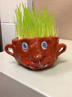 My fifth graders took a look at the art of face jugs in the South and we interpreted them in our own fun way. They made their pots using a s...