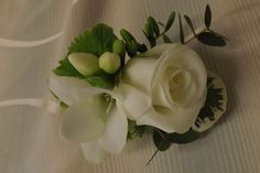 .freesia and rose buttonhole www.weddingflowersbylaura.com