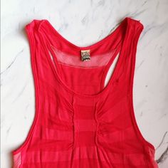 "Free People Destroyed Red Tank Top 🇺🇸 The perfect lake or beach day tank. Perfectly and intentionally destroyed (purchased as so) small holes here and there, great to throw over a swim suit with some denim shorts. Arm holes hang deep so it also looks great with bandeaus for a festival look. Really great tank! Perfectly ""grunge."" Size M but would fit a S better. Price isn't firm, make an offer! Free People Tops Tank Tops"