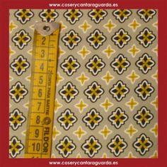Tela Element con motivos sobre fondo Caqui, doble ancho, corte desde 25cms. Corte desde 25cms x 145 cms.