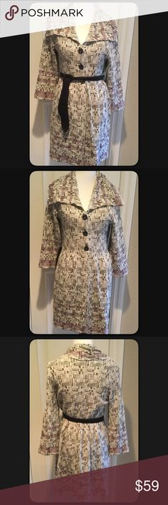 """🆕Nic + Zoe Knit Cardigan Coat NWOT Beautiful black, white and shades of purple trims Knit Long Cardigan Coat Style. Three buttons, swing style bottom. 3/4 sleeves. Measures approximately 36"""" long, armpit to armpit 17.5"""", sleeves armpit down 13"""". Measurments taken while lying flat. Black knit tie belt. Wear with or without belt. Material 70% cotton, 15% Viscose, 15% Nylon. Soft and comfortable. Sleeves are 3/4 length on me but I have long arms. Sleeves could be longer on yourself. Will…"""