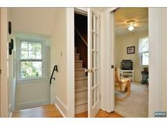 French door to walk-up attic. Great idea for making a finished attic feel more like a part of the house