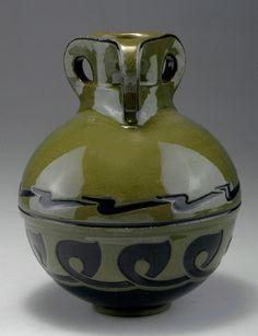 Henry van de Velde, Weimar. Vase, 1902/03. Made by Reinhold Hanke, Höhr. Stoneware, glazed olive-green, reliefed pattern in green-blue. Marked: Artist's signet, WESTERWALD ART POTTERY, 2055 B. Measures H. 21 cm.  |  SOLD 8,000 EUR, 2011