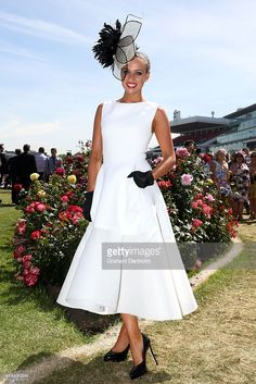 Myer Fashions on the Field Women's Racewear National Final winner Brodie Worrell poses on Oaks Day at Flemington Racecourse on November 6, 2014 in Melbourne, Australia.