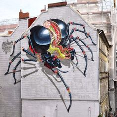 STREET ART BLACK WIDOW MURAL - Austrian street artist Nychos just wrapped up an epic giant-scale mural in Hamburg that must be seen to be believed. The giant aerosol painting depicts an enormous black widow in the midst of dissection with all manner of viscera and organs exposed in the kind of glorious, loving detail that is the artist's signature.