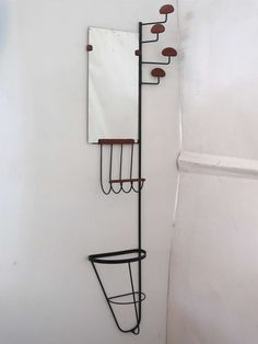 Rare Leather and Iron Wall Rack by Jacques Adnet | From a unique collection of antique and modern shelves and wall cabinets at http://www.1stdibs.com/furniture/wall-decorations/shelves-wall-cabinets/