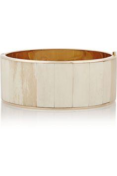 The choker, seen at Givenchy, J.W. Anderson, and Balmain, may just be this season's best accessory. Shop this Balmain Rose Gold-Tone Bone Choker and 10 more.