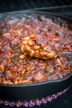 Smoked Baked Beans Recipe (Video and Post) - Four Kids and a Chicken - Grilling Recipes Smoked Baked Beans Recipe, Baked Bean Recipes, Smoked Meat Recipes, Beans Recipes, Venison Recipes, Smoked Pork, Rib Recipes, Traeger Recipes, Grilling Recipes