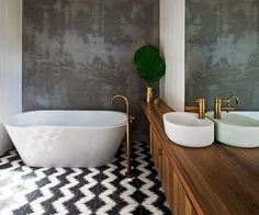 To create a peaceful retreat from the busyness of everyday life, this bathroom is cocooned in concrete render.