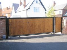 Our elegant 'Olivia' sliding gate is wooden cladded with steel frame and straight top.  This gate adds appeal to any entrance.