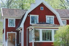 Traditional red old Swedish house with white trims