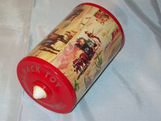 Vintage Cowboy Themed Roll Back Toy really does roll back to you... Very cute, has cowboys and indians theme all over.I believe its from the 1950s or 1960s