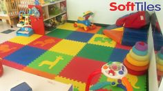 SoftTiles Safari Animals are used as an accent in this playroom floor.