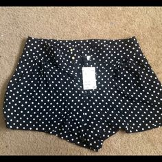 Black and white polka dot viscose shorts Light weight silky feel shorts. Never worn gold button details and pockets H&M Shorts