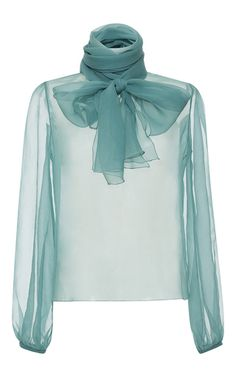 Rendered in silk, this **Blumarine** blouse features a tie at the neck, sheer full length sleeves, and a relaxed fit.