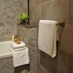 Contrast between large tiles & smaller 'brick-like' tiles for the bathroom.