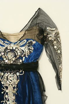 Blue silk velvet and black chiffon evening gown with metallic thread embroidery and mother-of-pearl sequins augmented with glass beads (detail), American, 1914-1920.