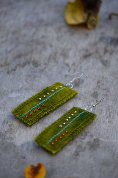 Green oblong abstract & ethnic earrings. Textile earrings with hand-stitched embroidery and glass beads. Woolen earrings. by Mioltu on Etsy https://www.etsy.com/listing/203373447/green-oblong-abstract-ethnic-earrings