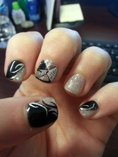 New years nails. Silver sparkle with black