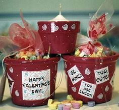 Cute Valentine's Gifts - clay pots painted and filled with treat bags full of candy...could be themed for any holiday or event!