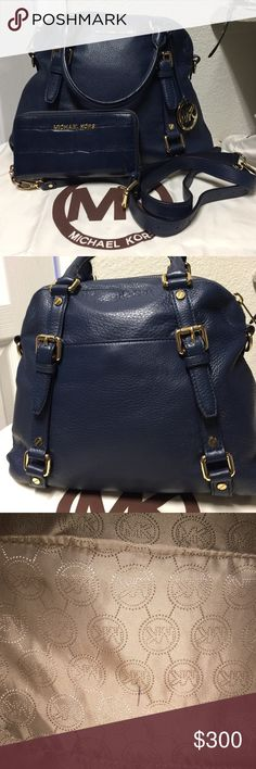 💜Michael Kors Large Bedford Navy Bag💜 Like New Condition!! This bag is stunning! It is buttery soft navy blue leather with gold tone hardware with an adjustable shoulder strap for cross body! Has been used once. This bag has a small tiny pen mark at the bottom of the bag. The wallet is a crock embossed wristlet that can hold an iPhone 6, has been used once for a couple of hours, no rips, stains or marks. Both the bag and wallet are in excellent used condition. Comes with dustbag. See add'l…