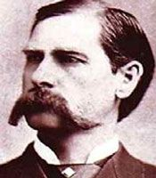 Lawman Wyatt Earp was born Wyatt Berry Strapp Earp in Monmouth, Illinois in 1848.  He was, perhaps, the west's most celebrated lawman even though only six of his 80 years were spent in that capacity.     He stood over six feet tall and was blond and blue-eyed. An impeccable dresser, he was known to never have left his house without coat and tie.    His first law-related job was in Lamar, Missouri in 1870 when he was appointed constable. But he left town in 1871 after his first wife, Urilla…