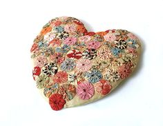 Antique Collectible Heart Pillow ... Yo Yo Quilt, Hand Sewn, Cushion, Red, White and Pink. Via Etsy.