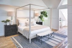 The vibrant Serena & Lily rug grounds the four-poster Noir bed and geometric bench by Oly in the master bedroom. Dark-stained bedside chests hold sculptural lamps—gifts from a friend's estate—with custom shades by Arendsen's company, Intimate Living Interiors.