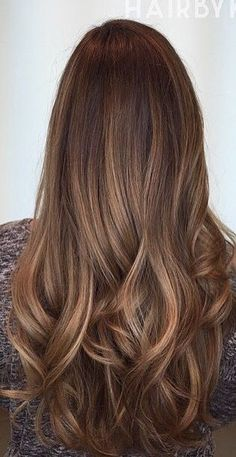 Brown hair with golden caramel highlights balayage