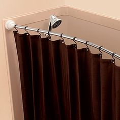 Rotating Curved Shower Curtain Rod: The space-saving Rotator Rod pivots in toward the shower while not in use while you use the rest of the bathroom!