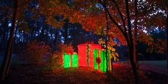 Create giant DIY lighted gift boxes for use as outdoor Christmas decorations using PVC pipes, holiday fabric and string lights.