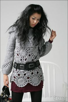 Leads to a google album full of crocheted clothes and a few patterns