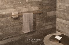 Designer Silvia Fanticelli's new TABL-EAU range for Salvatori combines natural stone and burnished brass in a natural evolution of its sister collection PLAT-EAU. Wall Railing, Stone Texture, Towel Rail, Bathroom Cabinets, Bathroom Sets, Geometric Shapes, Natural Stones, Door Handles, Wall Lights
