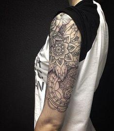 Black and White Arm Sleeve Tattoo.