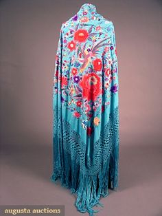 "EMBROIDERED FIGURAL EXPORT SHAWL, c. 1900    Multi-colored hand embroidered turquoise blue silk ground, 2 corners w/ large florals & 2 w/ Chinese figures, knotted silk fringe, 62"" x 70"", plus fringe 28"", (fringe tangled) excellent."