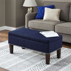 Kasey Storage Ottoman will make a great addition to your entryway, living room or bedroom. Its versatility allows it to be used as an ottoman or as a bench, depending on your needs. It features a sizable hinged storage compartment, great for storing gloves and scarves or blanket and pillows. The perfect solution to convenient seating, Kasey Storage Ottoman is traditional in style yet features modern touches. The linen-look fabric is soft to the touch and easy to care for. The individually…