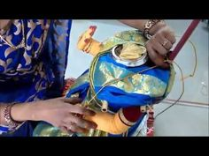 This Video shows how to tie saree for Goddess gowri with Hands and legs attached.
