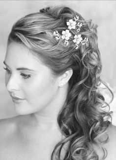 If you could find little flower hair jewelry in the secondary theme colors, something like this would be very neat for either the bridesmaids or the bride!