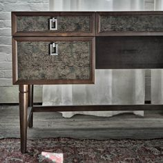 "Awesome mid-centry modern desk with embossed snakeskin print leather made by ""The New Traditionalists,"" a local Connecticut furniture company. Love the hardware too!"