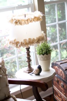 Thrift store find - shade had burlap ruffles added and base was painted from gold to perfect!
