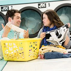 An adorable and funny engagement session at a laundromat by Lauren Reynolds Photography. Plus a save the date video created by the couple!