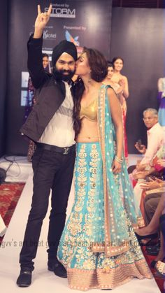 AD Singh at the kochi international fashion week season 2 along with bollywood actress Manjari Fadnis. Phadnis is dressed in aqua marine bridal lengha with a sexy gold bikini choli. AD Singh showcased an entire collection of bridal lenghas, sarees and gowns.