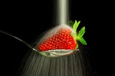 Sugar falls on a strawberry and looks like rain. Long exposure 1/15 to keep the action.